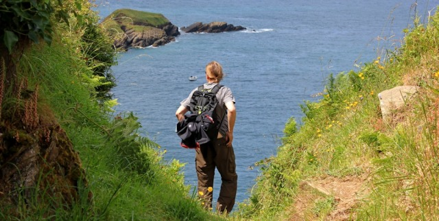 walker on Widmouth Head, Ruth on the SWCP, north Devon
