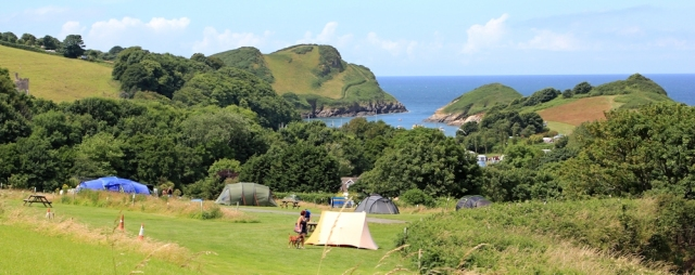 camp site above Water Mouth bay, Ruth walking the SWCP, Devon