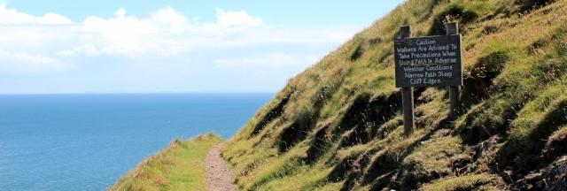 warning sign, Ruth walking the coast, Hurlstone Point