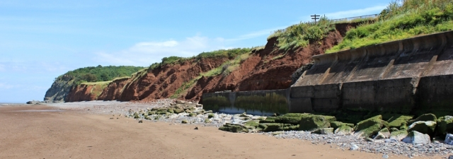 erosion, Blue Anchor, Ruth walking the coast in North Somerset