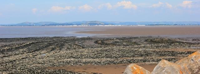 Burnham on Sea across Bridgwater Bay, Ruth walking the coast, Somerset