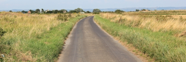 road walking to Steart, Ruth on Somerset Coast Path