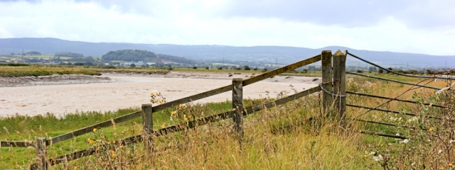 River Parrett Bank and Quantock Hills, Ruth walking the coast