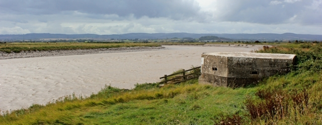 River Parrett pill box and Quantock Hills, Ruth walking the coast