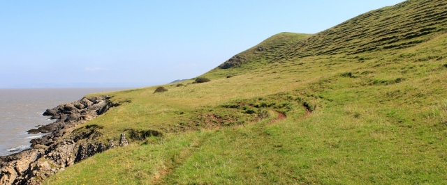 ancient tumuli and field systems, Ruth walking on Middle Hope, North Somerset coast