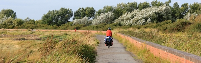cycle path into Burnham on Sea, Ruth walking the coast