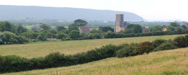 Woodspring Priory, Ruth walking the Somerset coast