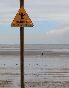 26 danger, sinking mud in Weston super Mare, Ruth walking the coast