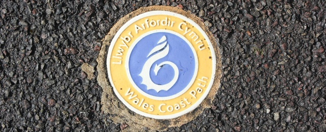 Wales Coast Path sign, embedded in pavement, Ruth's coast walk, Chepstow