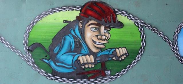 b04 cyclist, graffiti tunnel, Ruth walking towards Chepstow