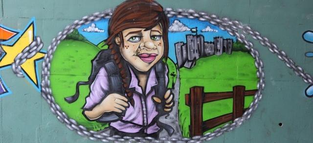 b05 hiker, graffiti tunnel, Ruth walking towards Chepstow