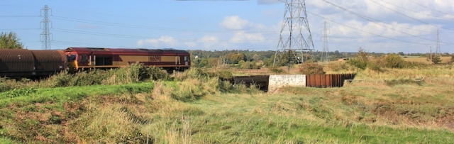 b05 over a railway line, Ruth walking the Coast Path, Wales, near Portskewett