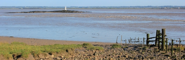 b10 Charston Rock and lighthouse, Ruth walking the Severn shore, Wales