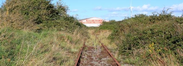 b12 railway line going nowhere, Ruth walking up the Severn Estuary