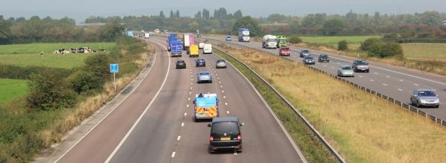 b14 over the M5 motorway again, Ruth walking in Somerset