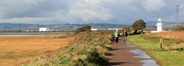 Ruth walking through Newport Wetlands, Wales Coast Path