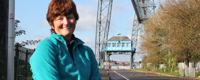 Ruth in front of Newport Transporter Bridge, Wales