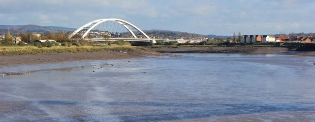 view back up River Usk, Ruth walking the Wales Coast Path
