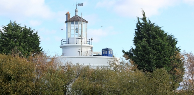 West Usk lightouse with Tardis, Ruth walking the Wales Coast Path