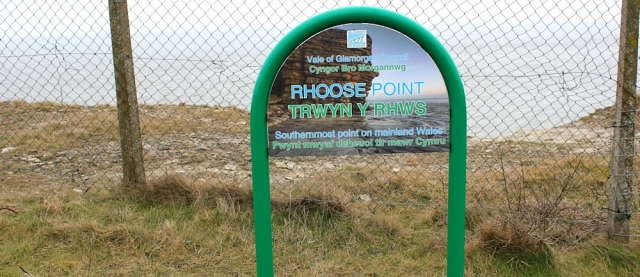 13 Rhoose Point sign, Ruth walking the coastline of Wales