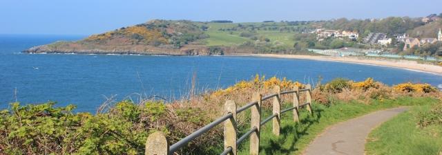 Langland Bay, Ruth walking the Wales Coast Path