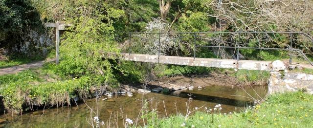 footbridge at Pwlldu Bay, Ruth walking in Wales