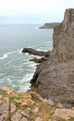 narrow corner, Ruth walking above Mewslade Bay