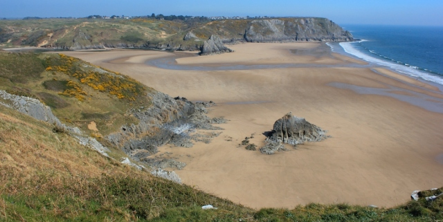 Three Cliff Bay, Ruth walking in Gower, Wales Coast Path