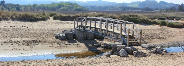 footbridge over stream, Ruth walking across Oxwich Bay