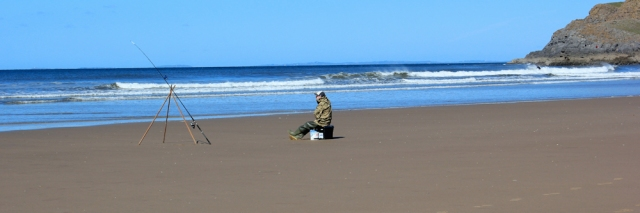 Fisherman, Rhossili Beach, Ruth walking the Wales Coast Path