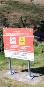 Danger sign on Twlc Point, Ruth Livingstone hiking in Gower, Wales