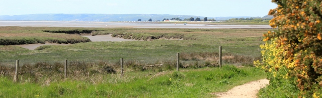 a03 footpath and view across Gwendreath Fach, Ruth hiking in Wales, Kidwelly