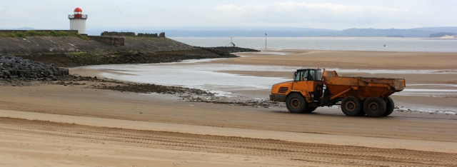 a05 removing sand from the beach, Burry Port, Ruth on her coastal walk in Wales