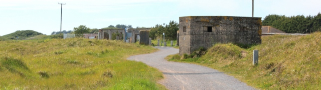 a12 pillbox near entry to Pembrey Country Park, Ruth walking the coast in Wales