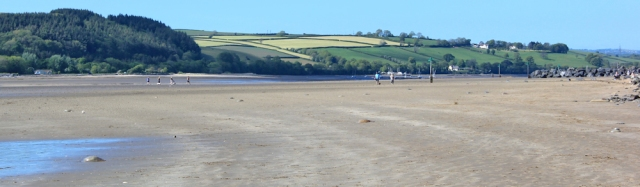 a18 beach at Ferryside, Ruth walking the Wales Coast Path