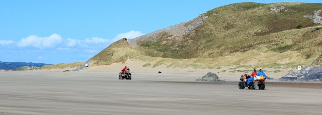 x04 buggies on Whiteford Sands, Ruth walking in Gower, Wales