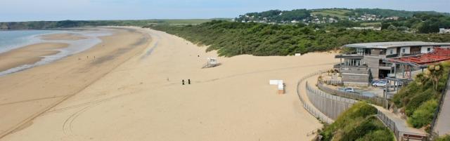 01 South Beach, Tenby, Ruth walking the Pembrokeshire Coast Path