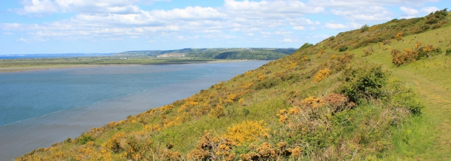 10 towards mouth of River Taf, Ruth walking th Wales Coast Path