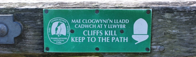cliffs kill sign, Ruth on the Pembrokeshire Coast Path