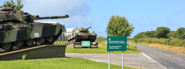 11 tanks at entrance to camp, Ruth Livingstone in Castlemartin
