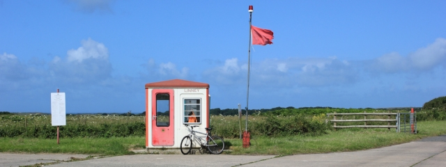 14 Linney checkpoint, with bicycle, Ruth walking past Castlemartin Ranges