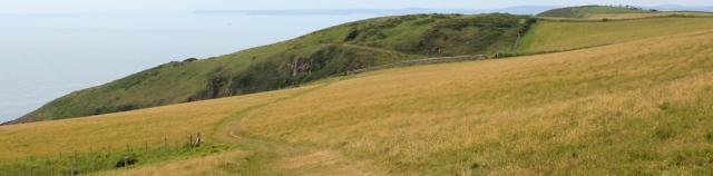 15 cliffs near Manorbier, Ruth walking in Wales