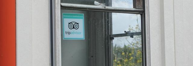 TripAdvisor sticker in checkpoint window, Ruth in Castlemartin