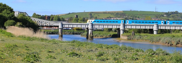 a05 train crossing over River Towy, Ruth walking the Wales Coast Path, Carmarthen