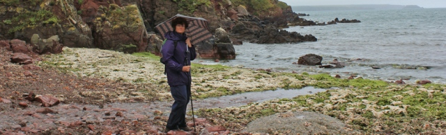 03 Ruth walking with an umbrella, Wales Coast Path