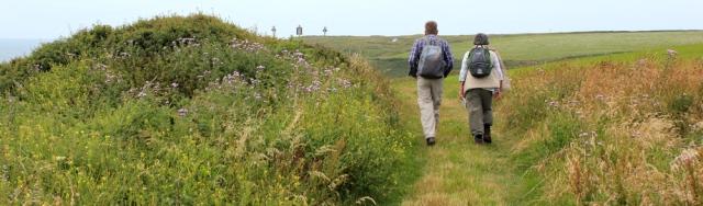 05 hikers walking towards St Ann's Head, Ruth in Pembrokeshire