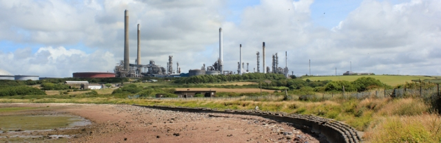 past oil refinery, Milford Haven, Ruth walking towards Pembroke
