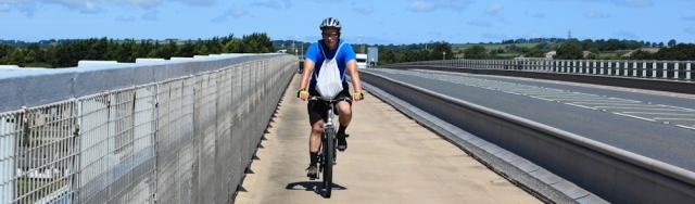 12 hubby cycling across Cleddau Bridge, Pembrokeshire