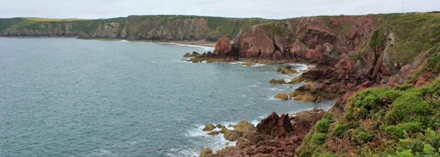 15 red rocks, Ruth walking the Pembrokeshire Coast Path