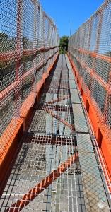 orange bridges, Ruth hiking in Milford Haven